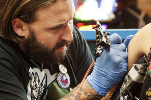 Nathan Haynes, Austin tattoo artist at True Blue Tattoo, appreciates tattooing for the cultural and aesthetic value, but also for the artistic process, which allows him to focus his attention on his work.