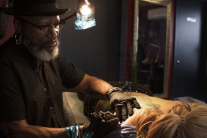 "A tattoo ""two-years in the making"" comes to life on the back of Lauren McIntyre. Austin, TX Zulu Tattoo artist and shop owner fixes McIntyre's old tattoo by decorating it with the organic, intricate lining characteristic of Art Nouveau."