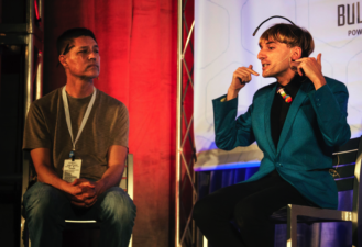 "Neil Harbisson & Richard MacKinnon during the ""Cyborg Pride & Identity"" panel."